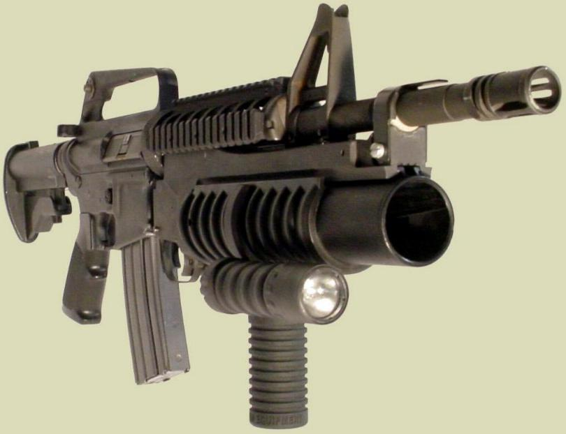 Shown is the M4 rifle with the M203 40mm grenade launcher and the M203grip with the Tactical Light accessory.  The flashlight accessory can also be added to create an M4 foregrip with flashlight or an M16 rifle flashlight.