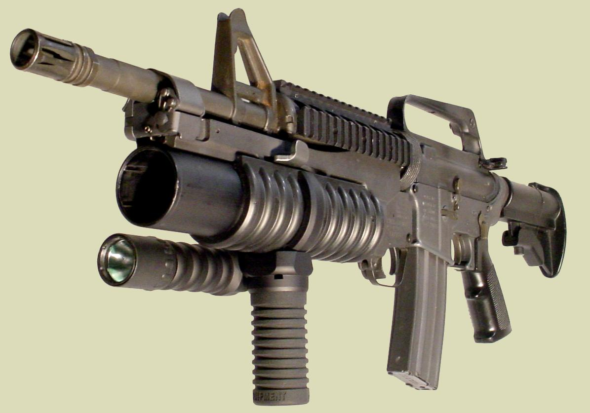 Photo: M4 rifle with the M203 grenade launcher. The M203grip with the Tactical Light is mounted on to the M203 handguard.