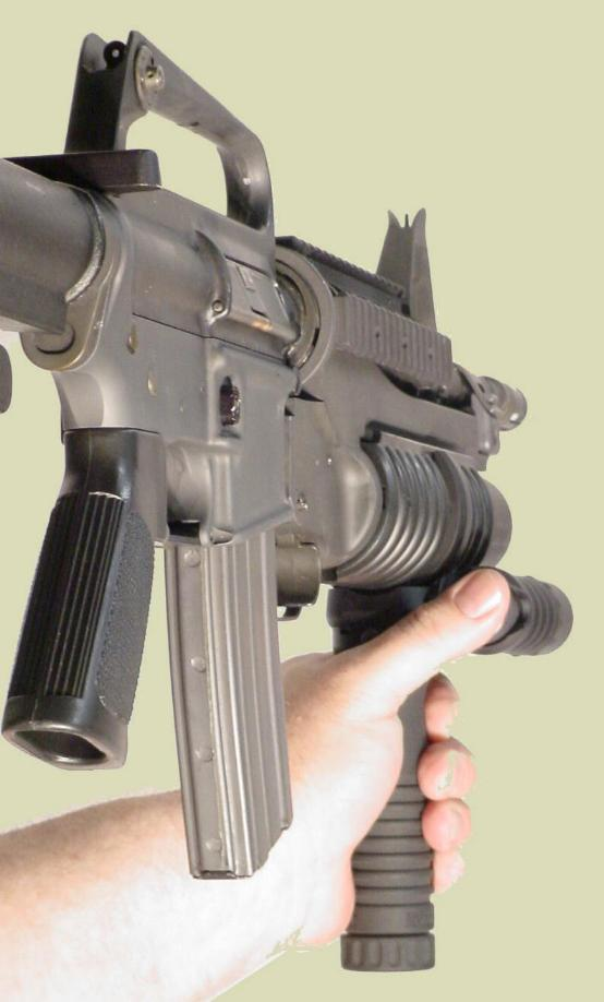Picture of the M4 rifle with the M203 40mm grenade launcher and the M203grip with the Tactical Light accessory.