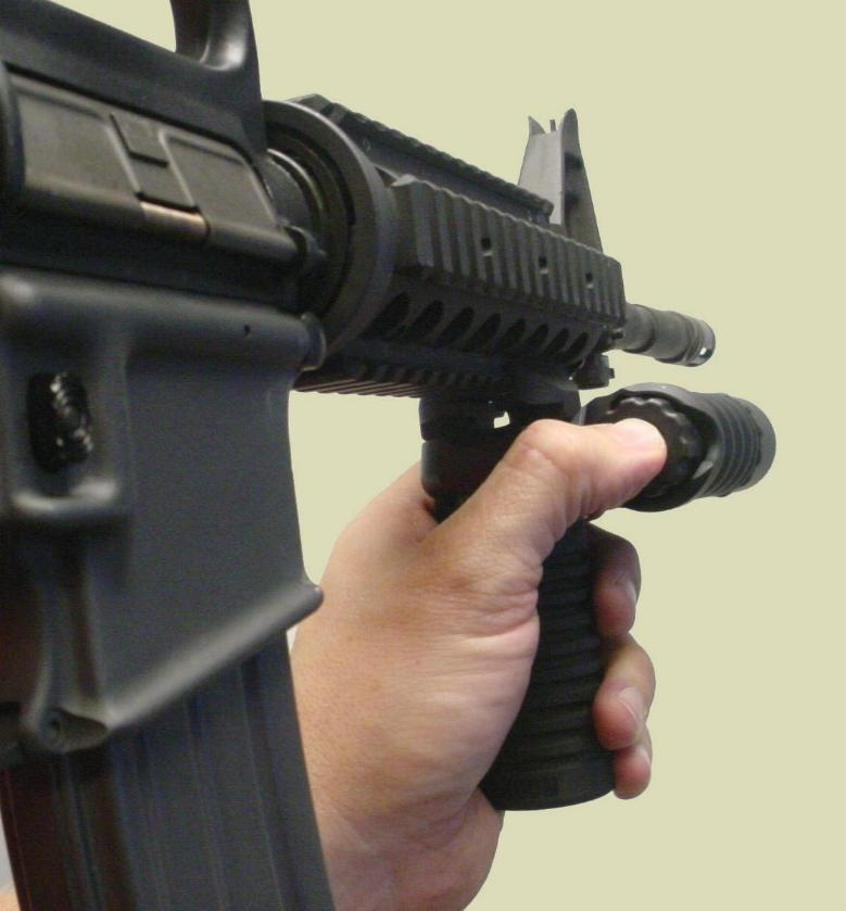 Picture of the M4 rifle with the RM Rail Grip with the Tactical Light accessory.