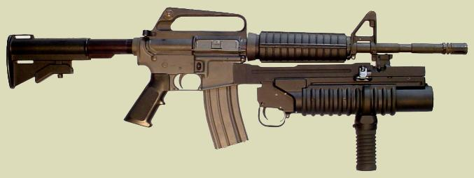 M203PI with the  M203 vertical grip (handgrip) on the M4 rifle. The M203grip is manufactured by RM Equipment, Inc.