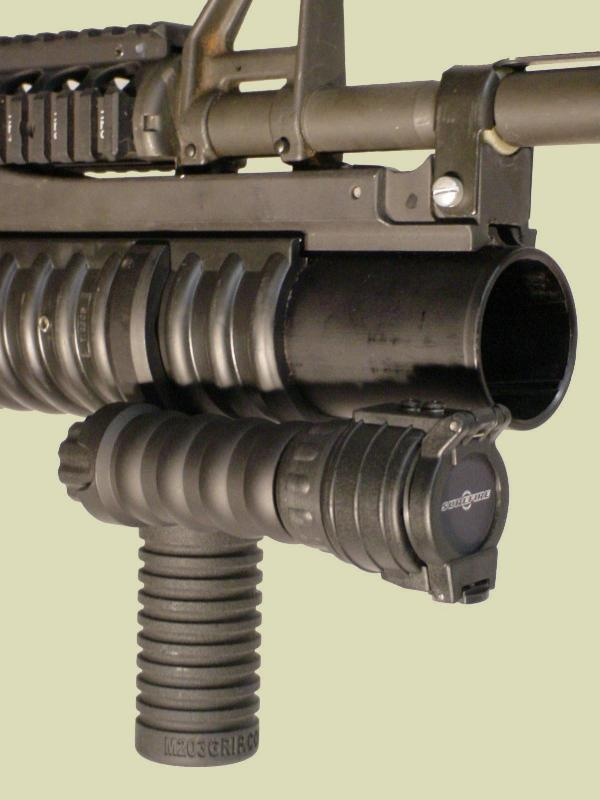 M203 with the M203grip and Tactical Light Module with the Surefire Tip Off Filter.