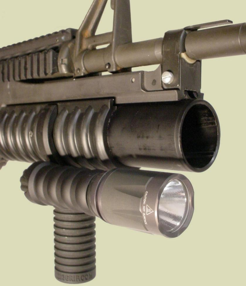 M203 with the M203grip and Tactical Light Module with the Surefire LED Head.